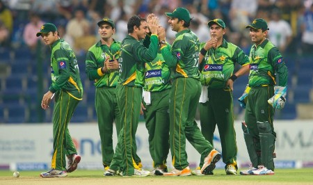 Pakistan players have a chat after dismissing a batsman