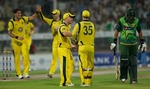 Australia celebrate after dismissing Nasir Jamshed