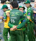 Kamran Akmal and Mohammad Hafeez embrace each other