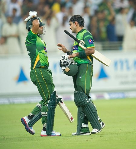 Mohammad Hafeez guides Umar Akmal