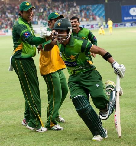 Umar Akmal led Pakistan to victory with a single of the last ball in the super over