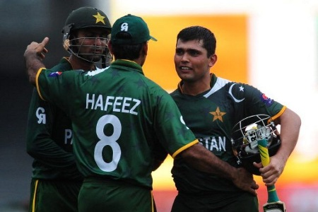 Mohammad Hafeez, Kamran Akmal and Shoaib Malik celebrate after winning the match