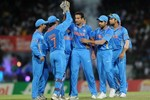 Indian players celebrate after taking a wicket