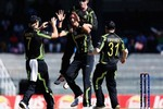 Australia celebrate after dismissing Kamran Akmal