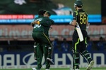 Kamran Akmal and Mohammad Hafeez embrace each other after winning the match