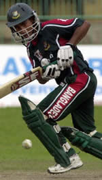 Mohammad Ashraful turns for a four