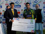 Skipper Mohammad Hafeez with the Player of the Match cheque