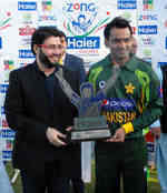 Skipper Mohammad Hafeez with the T20 series trophy