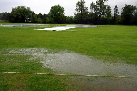 A view of the north-west pitch as heavy rain hit the ground
