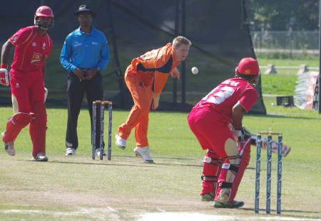 Timm van der Gugten bowls the opening ball to Hiral Patel