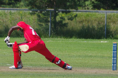 Kenneth Kamyuka stretches but falls LBW to spinner Pietar Seelar