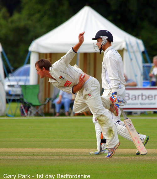 Garry Park in his follow-through while bowling for Norfolk against Bedfordshire