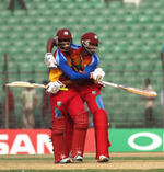 West Indies batsmen celebrate after scoring the winning runs