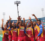 West Indies post for a photo after winning the match