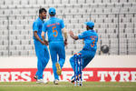 India celebrate after dismissing Gidron Pope