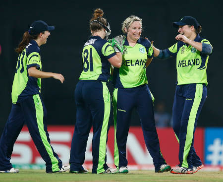 Ciara Metcalfe of Ireland is congratulated after taking the wicket of Trisha Chetty of South Africa