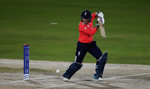 Tammy Beaumont of England hits the ball towards the boundary