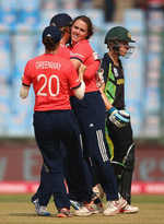 Natalie Sciver of England is congratulated on the wicket of Elyse Villani of Australia