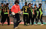 Meg Lanning, Captain of Australia is congratulated on the wicket of Tammy Beaumont of England