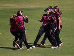 Lea Tahuhu of New Zealand is congratulated by her team mates after she catches out Alyssa Healy of Australia