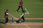 Ellyse Perry of Australia in action with Rachel Priest of New Zealand
