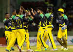 The Tallawahs embrace each other after getting a wicket