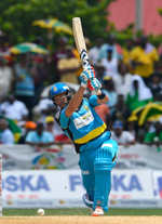 Shane Watson drives one for four