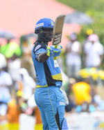 Johnson Charles celebrates his fifty
