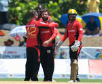 Knight Riders celebrate after getting a wicket