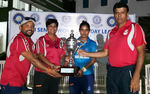 Mithali Raj and team management with the trophy