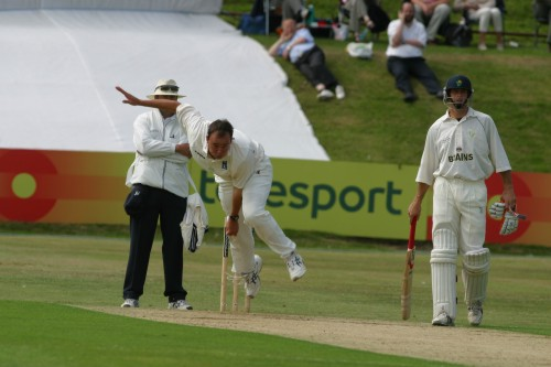 Neil Carter bowls from the Embankment End