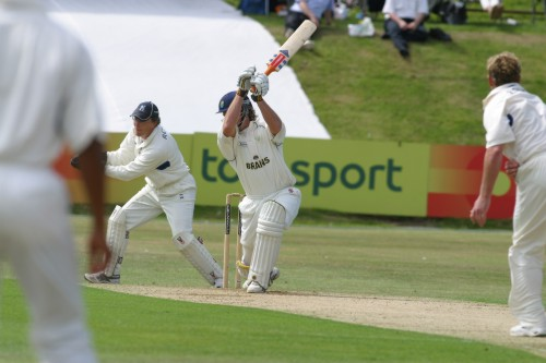 Mike Powell cover drives Dougie Brown