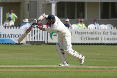 Nick Knight, the visiting captain, elegantly drives a ball for four
