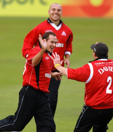 Dean Cosker celebrates after taking another wicket