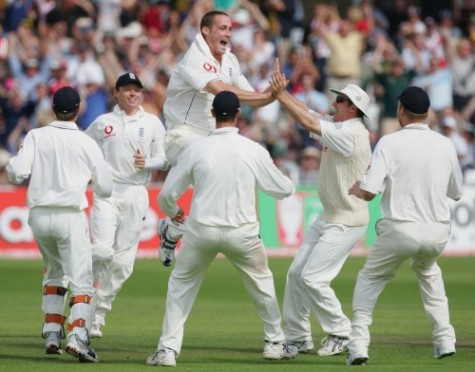 It's two in two for Simon as Shane Warne spoons a catch to cover