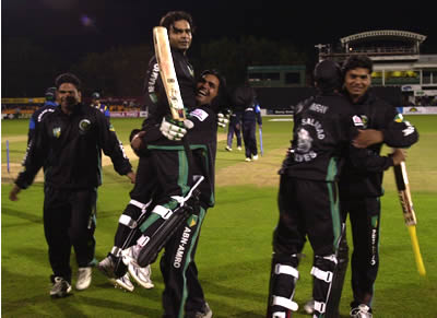 Faisalabad Wolves players welcoming Naved Latif (45*) and Imran Khalid (7*)