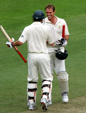 Matthew Hayden of Australia is congratulated by Adam Gilchrist after scoring a century