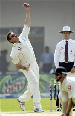 Ashley Giles about to deliver a ball