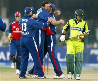 Steven Harmison celebrates with team after taking a wicket