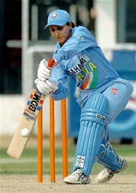Monica Sumra plays a shot