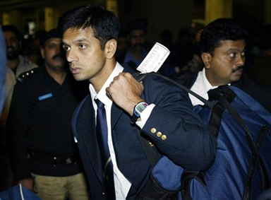 Rahul Dravid (L) arrives in Lahore