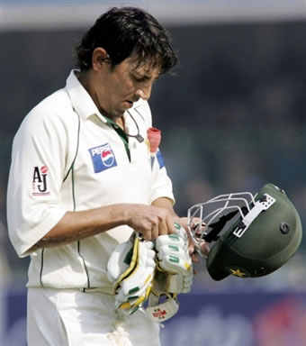 Younis Khan walks back to the pavilion