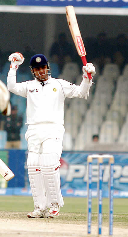 Virender Sehwag celebrating after his 100