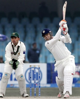 Virender Sehwag hits a boundary