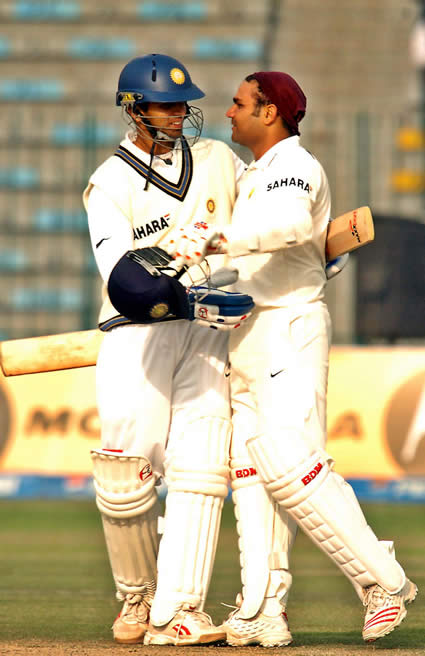 Rahul Dravid congratulating to Virender Sehwag after his 200