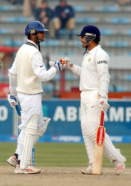 Virender Sehwag congratulating to Rahul Dravid after his 100