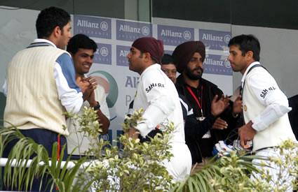 Rahul Dravid and Virender Sehwag congratulating by teammates