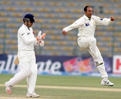 Naved-ul-Hasan celebrating after taking a wicket