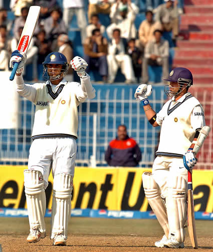 Dravid celebrates after his century