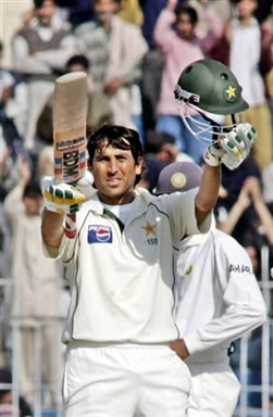 Younis Khan waves his bat after his century